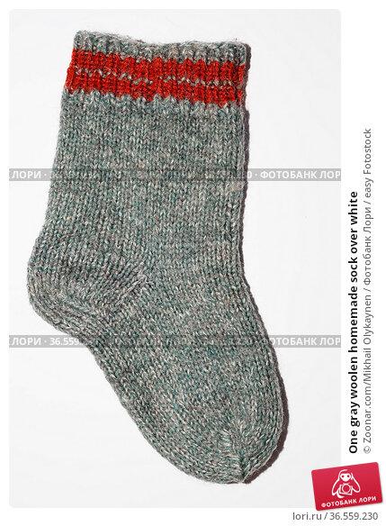 One gray woolen homemade sock over white. Стоковое фото, фотограф Zoonar.com/Mikhail Olykaynen / easy Fotostock / Фотобанк Лори