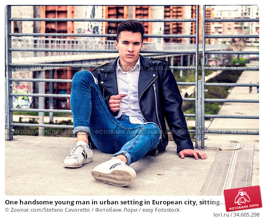 One handsome young man in urban setting in European city, sitting... Стоковое фото, фотограф Zoonar.com/Stefano Cavoretto / easy Fotostock / Фотобанк Лори