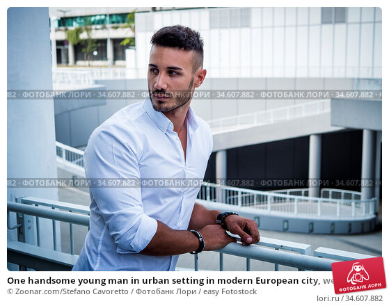 One handsome young man in urban setting in modern European city, wearing... Стоковое фото, фотограф Zoonar.com/Stefano Cavoretto / easy Fotostock / Фотобанк Лори