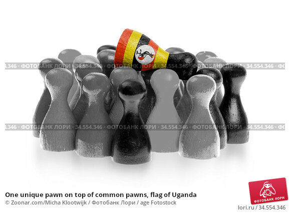 One unique pawn on top of common pawns, flag of Uganda. Стоковое фото, фотограф Zoonar.com/Micha Klootwijk / age Fotostock / Фотобанк Лори