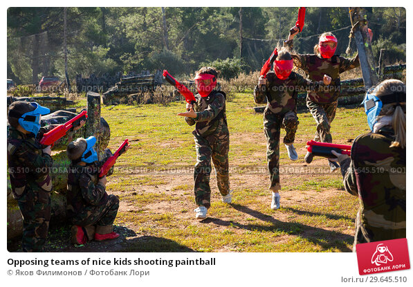 Купить «Opposing teams of nice kids shooting paintball», фото № 29645510, снято 24 ноября 2018 г. (c) Яков Филимонов / Фотобанк Лори