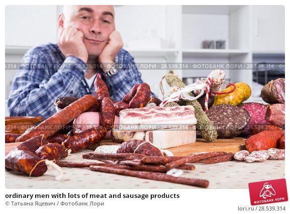 Купить «ordinary men with lots of meat and sausage products», фото № 28539314, снято 17 ноября 2016 г. (c) Татьяна Яцевич / Фотобанк Лори