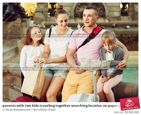 Купить «parents with two kids traveling together searching location on paper map», фото № 26969358, снято 13 августа 2017 г. (c) Яков Филимонов / Фотобанк Лори