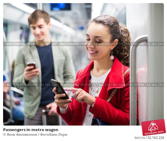 Купить «Passengers in metro wagon», фото № 32162226, снято 8 января 2020 г. (c) Яков Филимонов / Фотобанк Лори