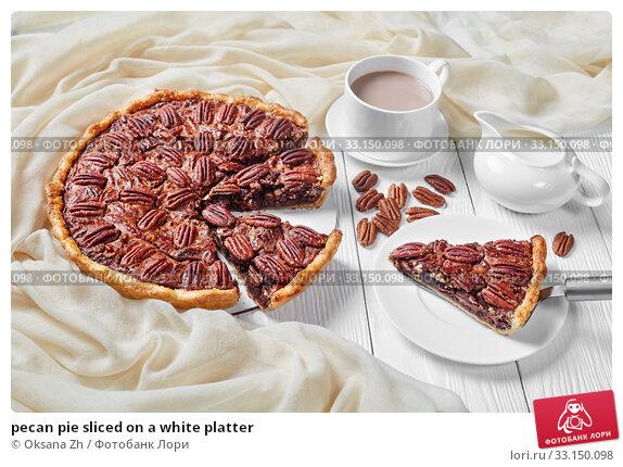 Купить «pecan pie sliced on a white platter», фото № 33150098, снято 19 ноября 2019 г. (c) Oksana Zh / Фотобанк Лори