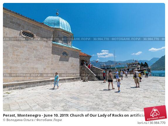 Купить «Perast, Montenegro - June 10. 2019: Church of Our Lady of Rocks on artificial island of Gospa od Skrpjela.», фото № 30984770, снято 10 июня 2019 г. (c) Володина Ольга / Фотобанк Лори
