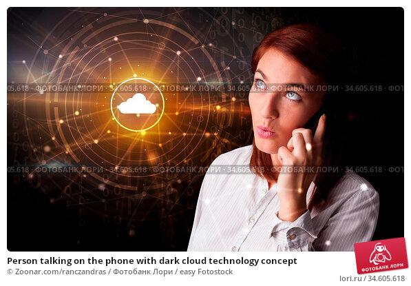 Person talking on the phone with dark cloud technology concept. Стоковое фото, фотограф Zoonar.com/ranczandras / easy Fotostock / Фотобанк Лори