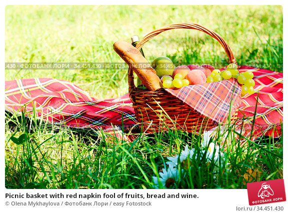 Picnic basket with red napkin fool of fruits, bread and wine. Стоковое фото, фотограф Olena Mykhaylova / easy Fotostock / Фотобанк Лори