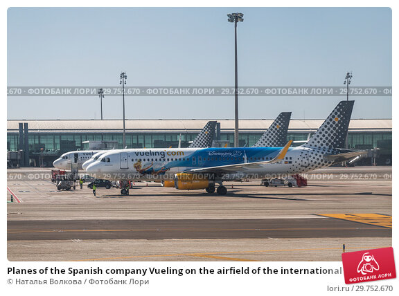Купить «Planes of the Spanish company Vueling on the airfield of the international airport El Prat, Barcelona, Spain», фото № 29752670, снято 4 апреля 2018 г. (c) Наталья Волкова / Фотобанк Лори