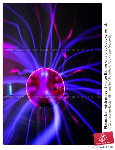 Plasma ball with magenta-blue flames on a black background. Стоковое фото, фотограф Zoonar.com/Ruslan Gilmanshin / age Fotostock / Фотобанк Лори