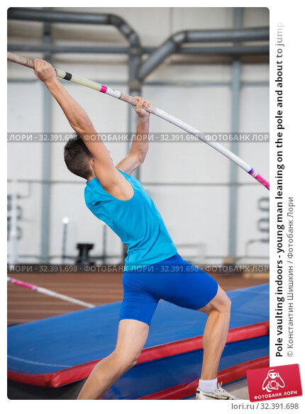 Купить «Pole vaulting indoors - young man leaning on the pole and about to jump», фото № 32391698, снято 1 ноября 2019 г. (c) Константин Шишкин / Фотобанк Лори