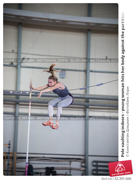 Купить «Pole vaulting indoors - young woman hits her body against the partition», фото № 32391666, снято 1 ноября 2019 г. (c) Константин Шишкин / Фотобанк Лори