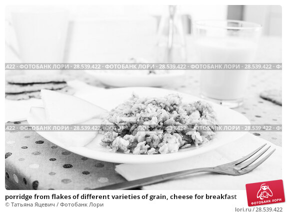 Купить «porridge from flakes of different varieties of grain, cheese for breakfast», фото № 28539422, снято 26 октября 2016 г. (c) Татьяна Яцевич / Фотобанк Лори