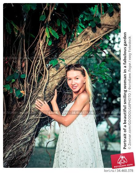 Portrait of a beautiful smiling woman in a fabulous garden. Стоковое фото, фотограф Zoonar.com/GOODOLGAPHOTO / easy Fotostock / Фотобанк Лори