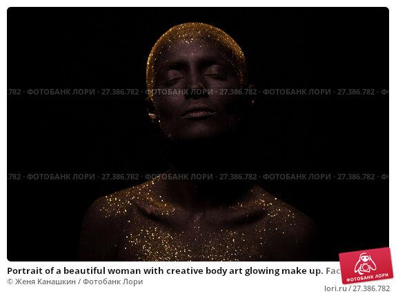 Купить «Portrait of a beautiful woman with creative body art glowing make up. Face is colored with black paint.», фото № 27386782, снято 7 января 2018 г. (c) Женя Канашкин / Фотобанк Лори