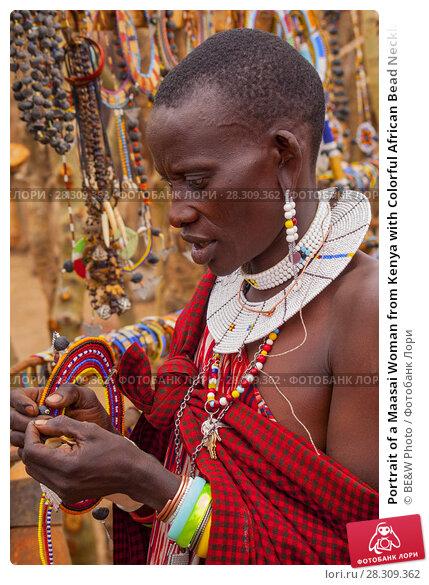 Купить «Portrait of a Maasai Woman from Kenya with Colorful African Bead Necklace Jewelry around her Neck», фото № 28309362, снято 25 марта 2019 г. (c) BE&W Photo / Фотобанк Лори