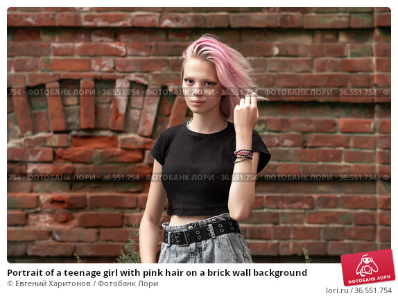 Portrait of a teenage girl with pink hair on a brick wall background. Стоковое фото, фотограф Евгений Харитонов / Фотобанк Лори