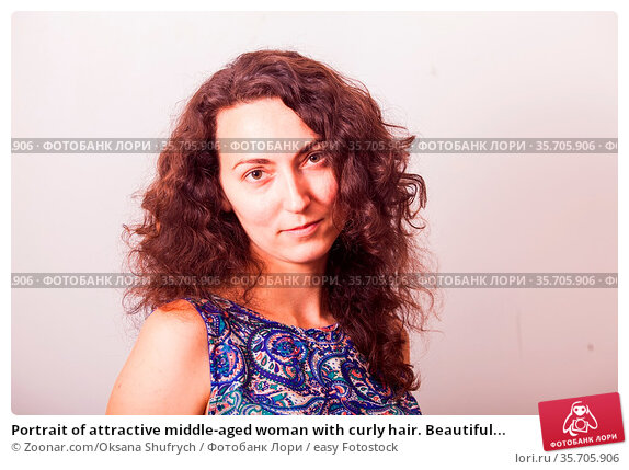 Portrait of attractive middle-aged woman with curly hair. Beautiful... Стоковое фото, фотограф Zoonar.com/Oksana Shufrych / easy Fotostock / Фотобанк Лори