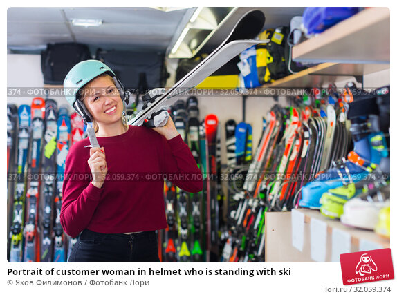 Portrait of customer woman in helmet who is standing with ski. Стоковое фото, фотограф Яков Филимонов / Фотобанк Лори