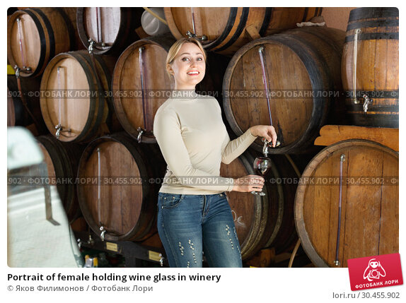 Portrait of female holding wine glass in winery. Стоковое фото, фотограф Яков Филимонов / Фотобанк Лори
