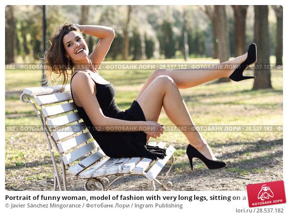 Купить «Portrait of funny woman, model of fashion with very long legs, sitting on a bench in an urban park, wearing black dress and high heels», фото № 28537182, снято 28 января 2015 г. (c) Ingram Publishing / Фотобанк Лори