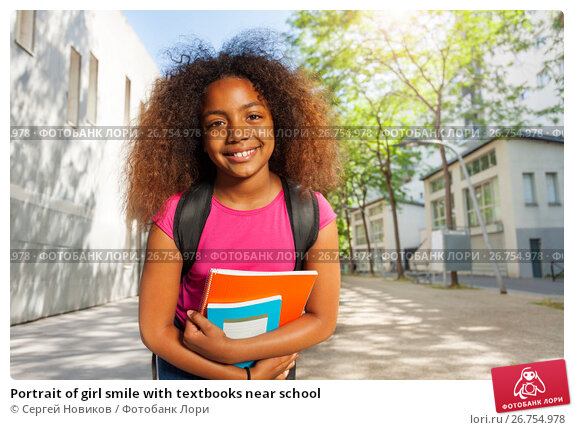 Portrait of girl smile with textbooks near school, фото № 26754978, снято 17 июня 2017 г. (c) Сергей Новиков / Фотобанк Лори
