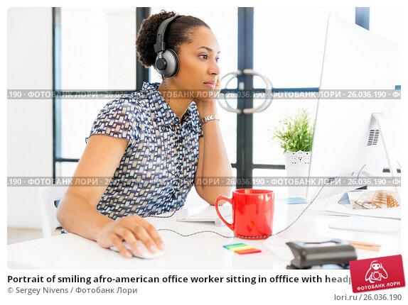 Купить «Portrait of smiling afro-american office worker sitting in offfice with headphones», фото № 26036190, снято 13 декабря 2014 г. (c) Sergey Nivens / Фотобанк Лори