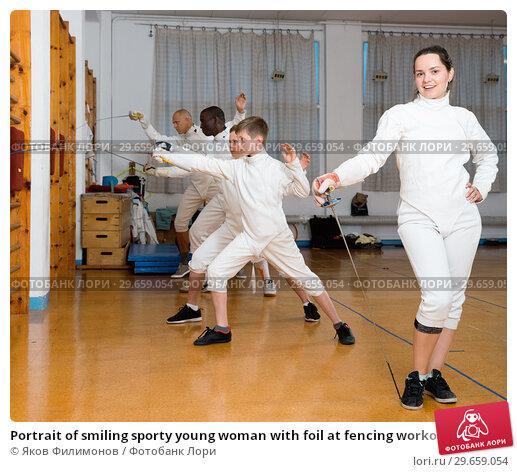 Купить «Portrait of smiling sporty young woman with foil at fencing workout», фото № 29659054, снято 30 мая 2018 г. (c) Яков Филимонов / Фотобанк Лори