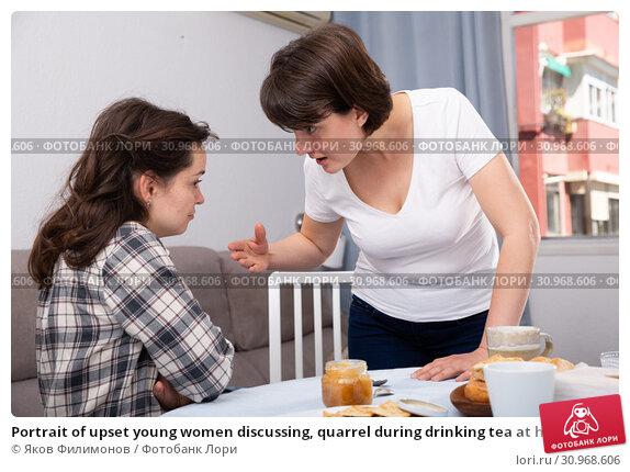 Купить «Portrait of upset young women discussing, quarrel during drinking tea at home kitchen», фото № 30968606, снято 17 июля 2019 г. (c) Яков Филимонов / Фотобанк Лори