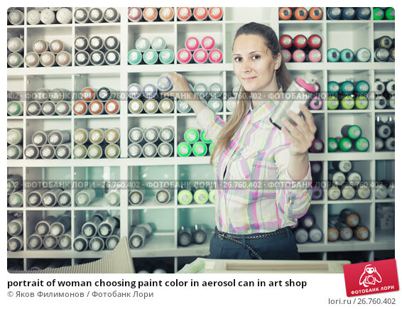 portrait of woman choosing paint color in aerosol can in art shop, фото № 26760402, снято 12 апреля 2017 г. (c) Яков Филимонов / Фотобанк Лори