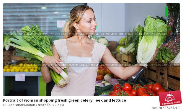 Купить «Portrait of woman shopping fresh green celery, leek and lettuce», фото № 27785410, снято 19 августа 2019 г. (c) Яков Филимонов / Фотобанк Лори