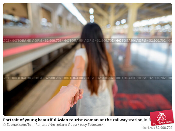 Portrait of young beautiful Asian tourist woman at the railway station in Bangkok, Thailand. Стоковое фото, фотограф Zoonar.com/Toni Rantala / easy Fotostock / Фотобанк Лори