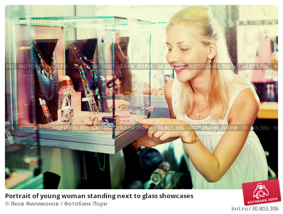 Купить «Portrait of young woman standing next to glass showcases», фото № 30803306, снято 26 июня 2019 г. (c) Яков Филимонов / Фотобанк Лори