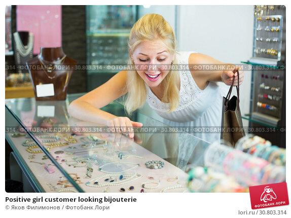 Купить «Positive girl customer looking bijouterie», фото № 30803314, снято 16 июня 2019 г. (c) Яков Филимонов / Фотобанк Лори