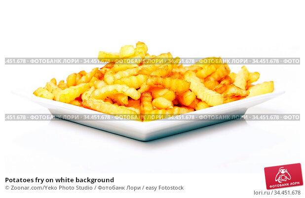 Potatoes fry on white background. Стоковое фото, фотограф Zoonar.com/Yeko Photo Studio / easy Fotostock / Фотобанк Лори