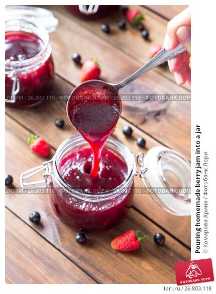 Купить «Pouring homemade berry jam into a jar», фото № 26803118, снято 15 ноября 2018 г. (c) Комарова Арина / Фотобанк Лори