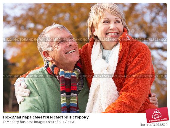 Купить «Пожилая пара смеется и смотри в сторону», фото № 3073522, снято 12 ноября 2008 г. (c) Monkey Business Images / Фотобанк Лори