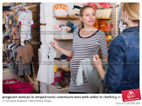 Купить «pregnant woman in striped tunic communicates with seller in clothing store», фото № 28539334, снято 6 апреля 2017 г. (c) Татьяна Яцевич / Фотобанк Лори