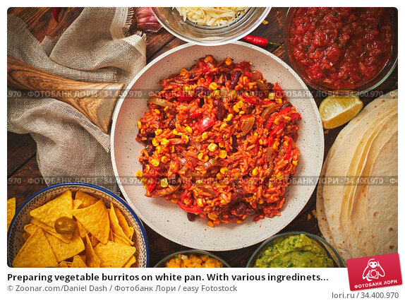 Preparing vegetable burritos on white pan. With various ingredinets... Стоковое фото, фотограф Zoonar.com/Daniel Dash / easy Fotostock / Фотобанк Лори