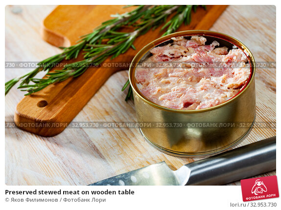 Preserved stewed meat on wooden table. Стоковое фото, фотограф Яков Филимонов / Фотобанк Лори