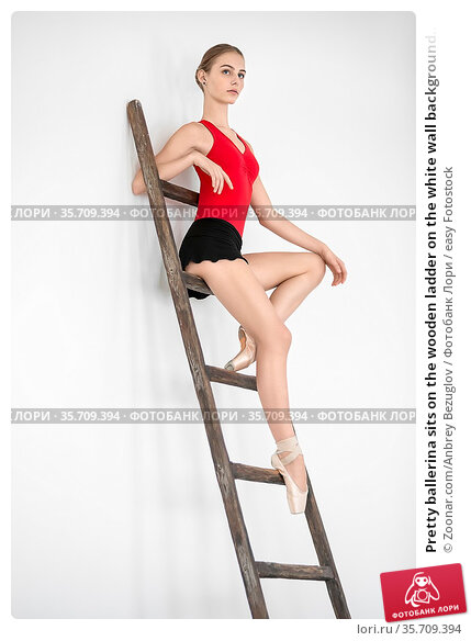 Pretty ballerina sits on the wooden ladder on the white wall background... Стоковое фото, фотограф Zoonar.com/Anbrey Bezuglov / easy Fotostock / Фотобанк Лори