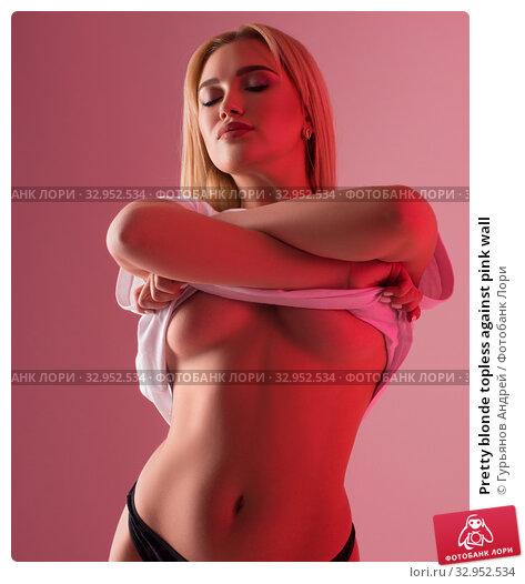 Pretty blonde topless against pink wall. Стоковое фото, фотограф Гурьянов Андрей / Фотобанк Лори