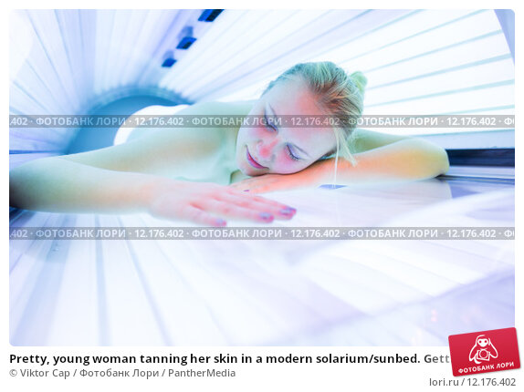 Купить «Pretty, young woman tanning her skin in a modern solarium/sunbed. Getting an energy boost during dark winter days.», фото № 12176402, снято 14 марта 2020 г. (c) PantherMedia / Фотобанк Лори