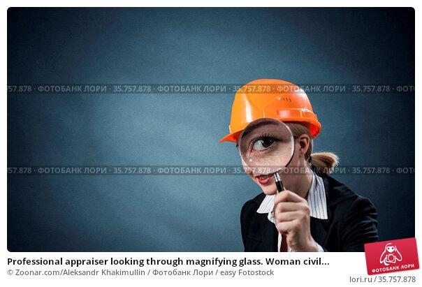 Professional appraiser looking through magnifying glass. Woman civil... Стоковое фото, фотограф Zoonar.com/Aleksandr Khakimullin / easy Fotostock / Фотобанк Лори