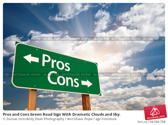 Pros and Cons Green Road Sign With Dramatic Clouds and Sky. Стоковое фото, фотограф Zoonar.com/Andy Dean Photography / age Fotostock / Фотобанк Лори