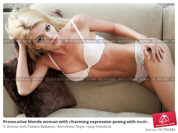Provocative blonde woman with charming expression posing with nude... Стоковое фото, фотограф Zoonar.com/Tatiana Badaeva / easy Fotostock / Фотобанк Лори