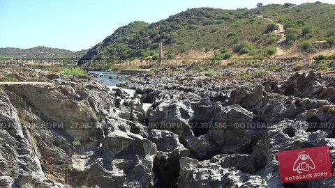 Купить «Pulo do Lobo or wolf's leap waterfall and cascade on river Guadiana, Alentejo, Portugal», видеоролик № 27387586, снято 25 ноября 2017 г. (c) Serg Zastavkin / Фотобанк Лори