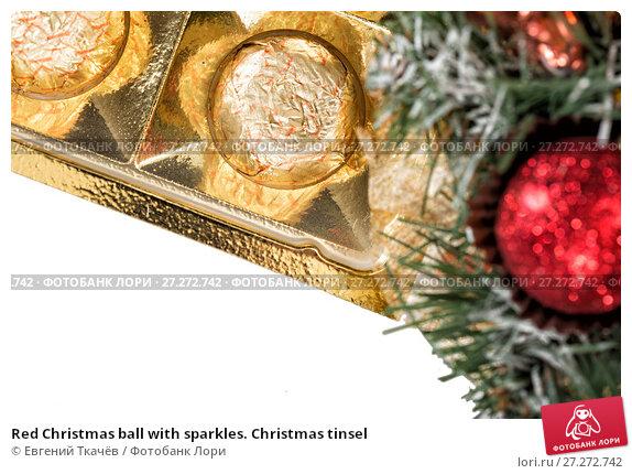 Купить «Red Christmas ball with sparkles. Christmas tinsel», фото № 27272742, снято 19 января 2016 г. (c) Евгений Ткачёв / Фотобанк Лори
