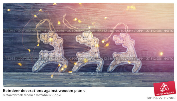 Купить «Reindeer decorations against wooden plank», фото № 27112986, снято 24 ноября 2017 г. (c) Wavebreak Media / Фотобанк Лори