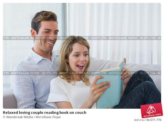 Купить «Relaxed loving couple reading book on couch», фото № 30071770, снято 17 декабря 2013 г. (c) Wavebreak Media / Фотобанк Лори